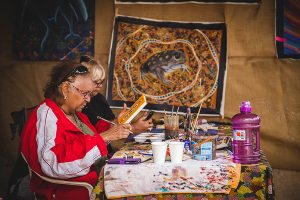 Admire the Aboriginal artists at work and purchase a painting